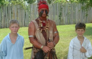 Indian and two boys at 225th anniversary reenactment of Camden battle